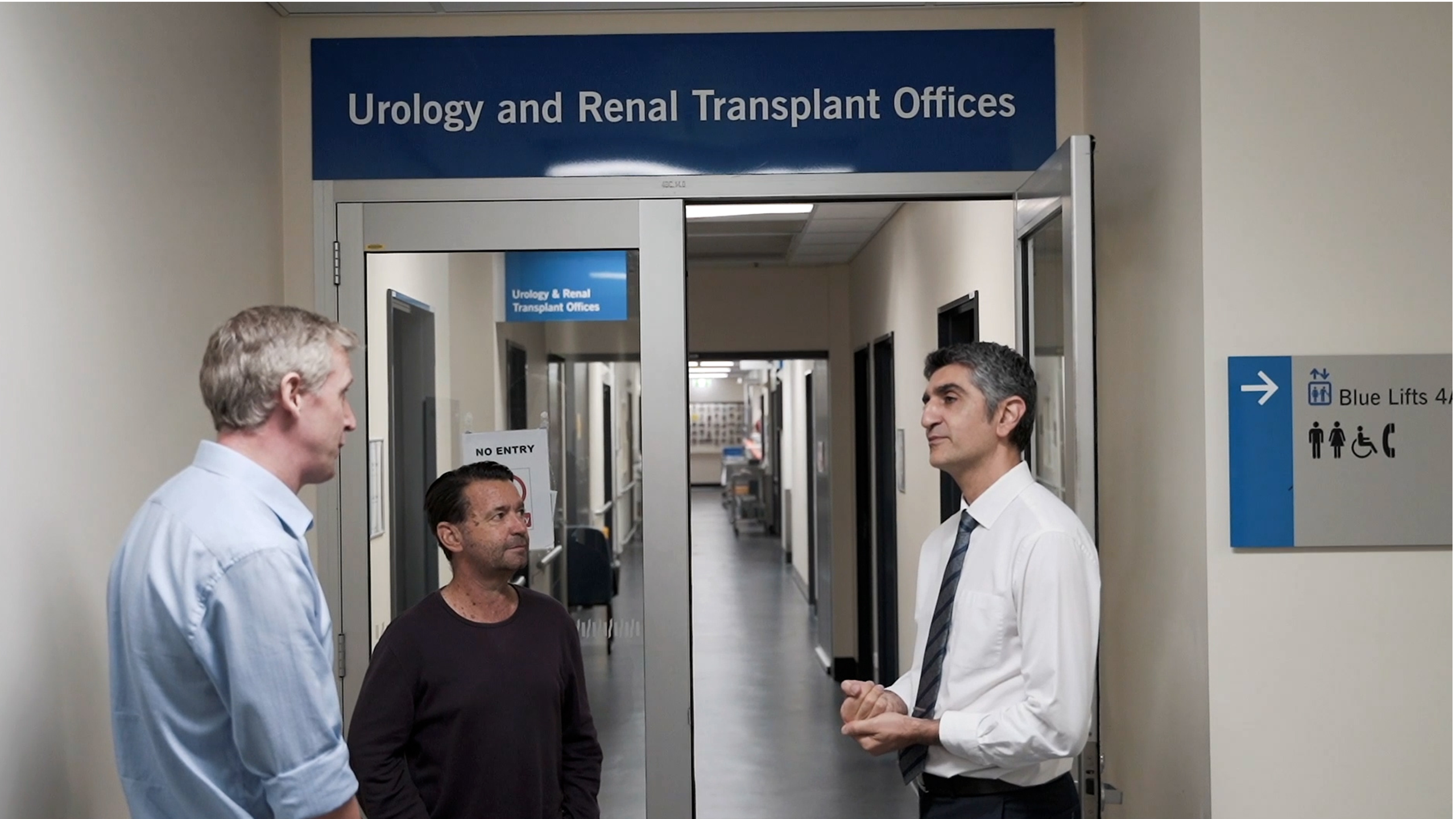 Associate Professor James Wells, Matty Hempstalk and Professor Kiarash Khosrotehrani stand in front of the transplant offices at the PA Hospital.